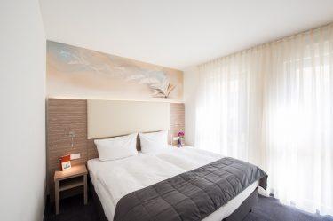 Buchstäblich wohlfühlen im Comfort-Zimmer im Book Hotel Leipzig